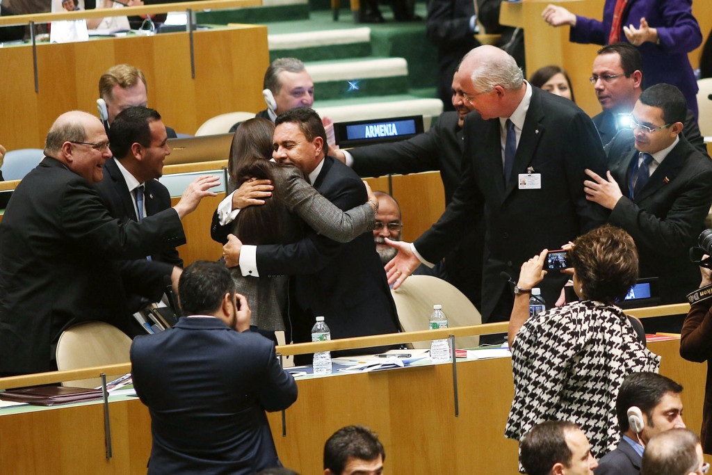 U.N. representatives for Venezuela, including Foreign Minister Rafael Ramirez, right, celebrate after being elected to the Security Council. Picture by Spencer Platt | Getty Images